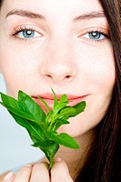 Young woman holding fresh herbs (thumbnail)