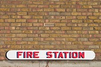 text, information, close_up, outdoors, signboard, fire station