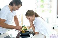 couple making breakfast