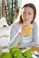 Woman drinking orange juice (thumbnail)