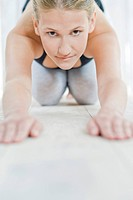 Young woman doing yoga (thumbnail)