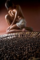 Woman with coffee grains