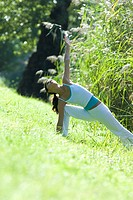 Young woman exercising in park (thumbnail)