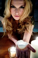 Young woman with candles (thumbnail)