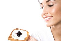 Woman eating toast with cottage cheese and jam