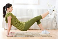 Young woman exercising at home (thumbnail)