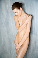 Nude woman covering her body (thumbnail)