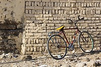 Bicycle, Brick Wall, Building, Day, Dirt Road