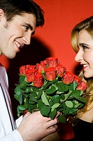 Couple with bouquet of red roses