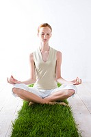 Young woman meditating (thumbnail)