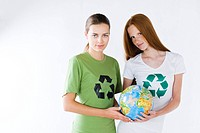 two girls holding globe