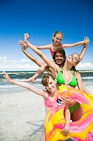 Happy family on beach (thumbnail)