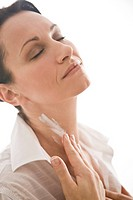 Woman creaming neck (thumbnail)