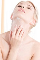 woman creaming neck