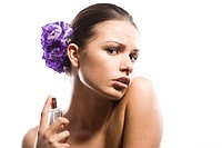 woman perfuming neck