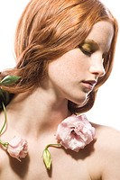 Young woman with rose on neck (thumbnail)