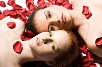Two women in roses patals (thumbnail)