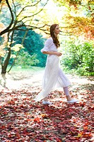 Joyful ginger woman in park (thumbnail)