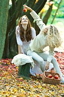 Young women relaxing in park (thumbnail)