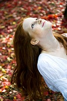 Ginger woman relaxing in park