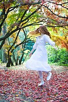 Ginger woman dancing in park