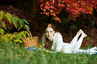 Young woman relaxing in park (thumbnail)