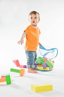 baby tidy up bricks into bag