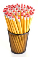 Group of pencils in a pencil holder with eraser ends up (thumbnail)