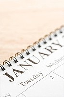 Close up of spiral bound calendar displaying month of January