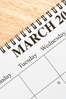 Close up of spiral bound calendar displaying month of March