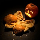 Upset jack-o'-lantern looking at smashed pumpkin (thumbnail)