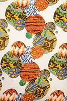 Close_up of colorful vintage fabric with orbs of abstract designs printed on polyester