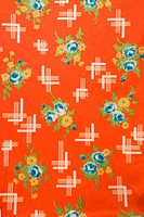 Close_up of red vintage fabric with colorful flowers printed on polyester