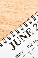 Close up of spiral bound calendar displaying month of June