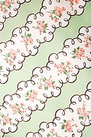 Close_up of vintage fabric with pink flowers in wide stripes printed on polyester