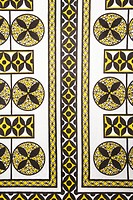 Close_up of vintage fabric with black and yellow shapes and patterns printed on polyester