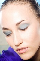 young woman with blue make_up