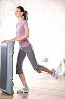 woman exercising with step