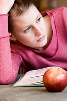 student with book and apple