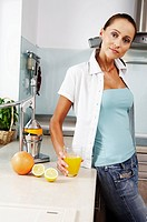 woman holding glass with fresh orange juice