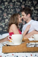 couple eating breakfast in bed