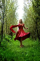 Young woman dancing in forrest