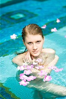 Beautiful young woman in pool