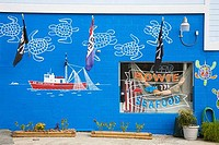 Mural on the wall of a seafood store, Tybee Island, Georgia, USA