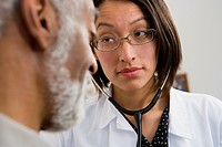 Native American doctor examining patient