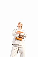 Businesswoman holding folder, low angle view, cut out (thumbnail)