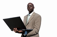 Businessman with laptop computer, cut out (thumbnail)