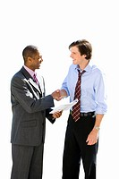 Businessman with paperwork shaking hands with associate, side view, cut out (thumbnail)