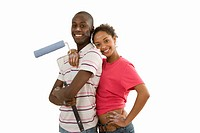 Young couple home decorating, man with paint roller, woman embracing man, smiling, portrait, cut out (thumbnail)