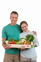 Couple with box of vegetables, smiling, portrait, cut out (thumbnail)